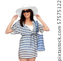 young woman in striped tunic and sun hat 57575122