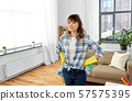 asian woman with rag and detergent cleaning home 57575395