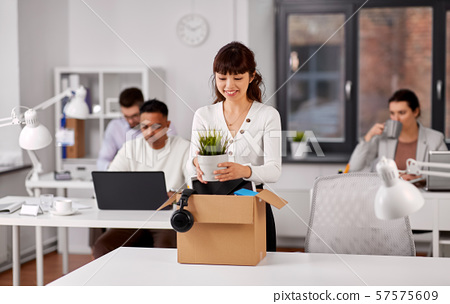 happy employee with personal stuff at office 57575609