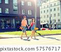 teenage couple with skateboards on city street 57576717