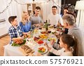happy family having dinner party at home 57576921