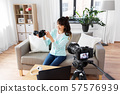 asian female blogger with camera recording video 57576939