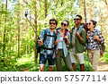 friends with backpacks hiking and taking selfie 57577114