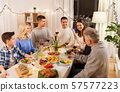 happy family having dinner party at home 57577223