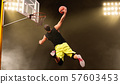 Basketball player makes shoot in jump 57603453