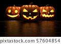 Three halloween pumpkin on dark background. 3D Rendering illustration 57604854
