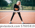 Young beautiful woman playing tennis on court. Healthy sport lifestyle 57605819