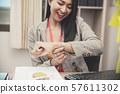 Professional Business woman seeing wrist watch 57611302