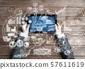 Concept of business strategy and planning with tablet on wooden table 57611619