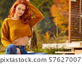 Beautiful girl resting and sitting in autumn 57627007