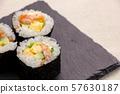 Salmon salad roll (on slate plate). 57630187