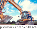 Construction worker on excavator planning the work to be done 57640326