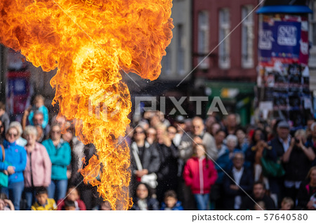 Fire performance includes skills based on juggling, baton twirling, poi spinning, and other forms of 57640580