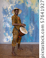 African man in traditional clothes playing djembe drum 57641927