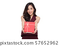 Happy beautiful asian woman smile with red gift 57652962
