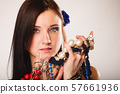 summer girl with plenty of jewellery, beads in 57661936
