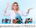 female chemistry student with test flask open palm 57662525