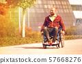 happy man on wheelchair 57668276