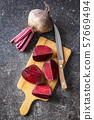 Sliced tasty raw beetroot and knife. 57669494