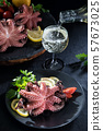 Stuffed octopus in white wine with lemon and 57673025