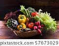 Organic fresh vegetables in basket on dark wooden 57673029