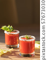 Beautiful tomato juice in glasses with celery, 57673030