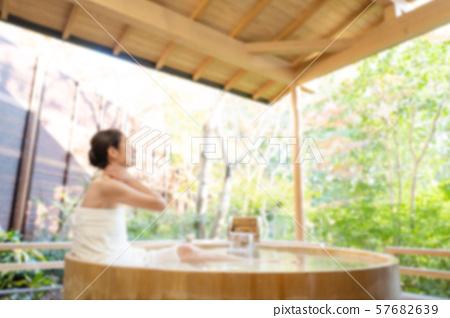 Senior woman open-air bath bathing hot spring travel image 57682639