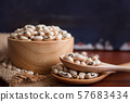Black-eyed beans in wooden bowl on a rustic table. 57683434