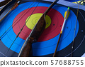 Bow and arrow with an archery target 57688755