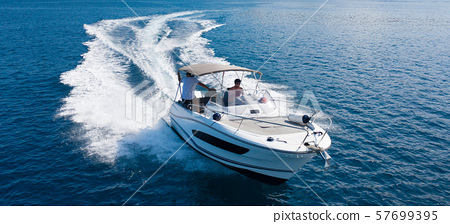 High speed motor boat on open sea. 57699395