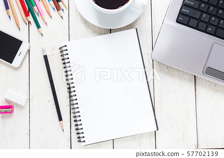 Empty notebook and colorful pencils on white wooden table 57702139
