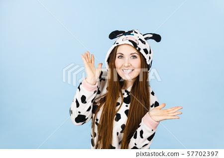 Woman wearing pajamas cartoon smiling 57702397