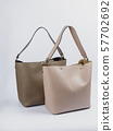 Two stylish women bags on a white background. 57702692