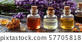 Panoramic header of essential oil bottles with frankincense, benzoin and lavender flowers 57705818