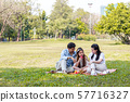 Asian families relax in the park 57716327