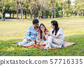 Asian families relax in the park 57716335