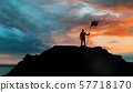 silhouette of businessman with flag on mountain 57718170