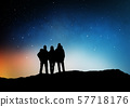 travelers or friends on edge over night sky 57718176