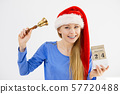 Christmas woman holding calendar and bell 57720488