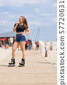Roller skate woman eating ice cream 57720631