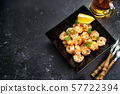 Fried prawns in a black square plate 57722394