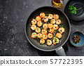 Top view of fried prawns in a pan on black table 57722395