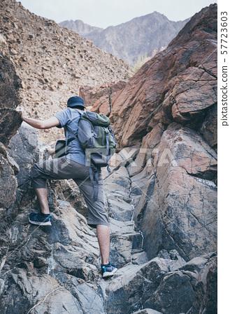Hiking in Hajar Mountains in UAE 57723603
