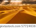 Sunset over the sand dunes in the desert 57724636