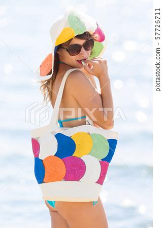 Elegant slim girl by the sea 57726711