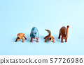 Tower of toy dinosaurus on blue background. Funny prehistoric poster. Copy space 57726986