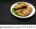 Chicken grilled steak on leaves slate on a white 57731071