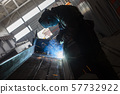 Industrial Worker at the factory welding closeup in glasses sparks 57732922