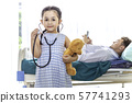 Little girl playing and examining pediatrician 57741293