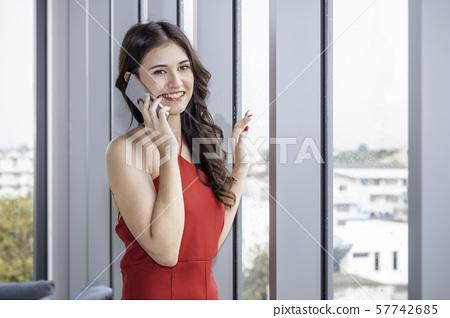 Beautiful  Caucasian woman holding phone on 57742685